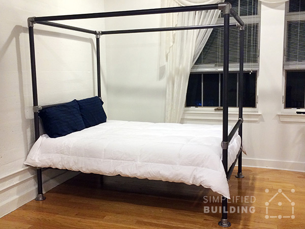 47 diy bed frame ideas built with pipe simplified building inspired by a few of the bed frames on our blog robert decided to build this queen size canopy bed frame as an alternative to more expensive options he solutioingenieria Choice Image