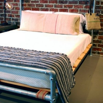Pipe Bed Against Red Brick Wall