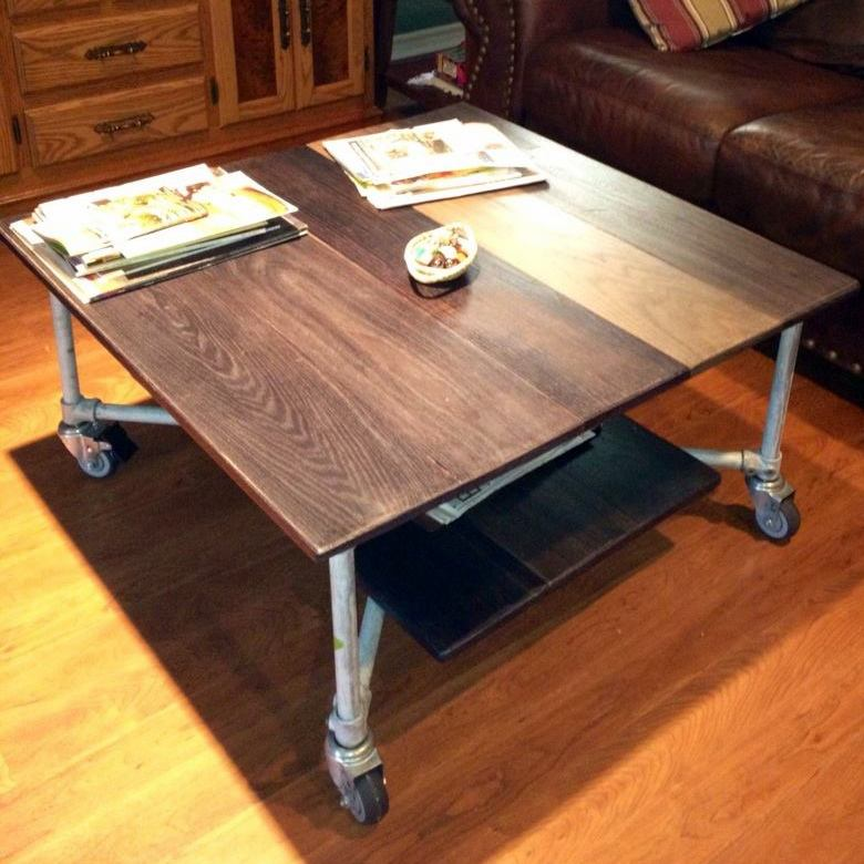 Aged metal and oak board rolling coffee table