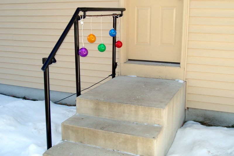 metal stair railing mounted to side of steps