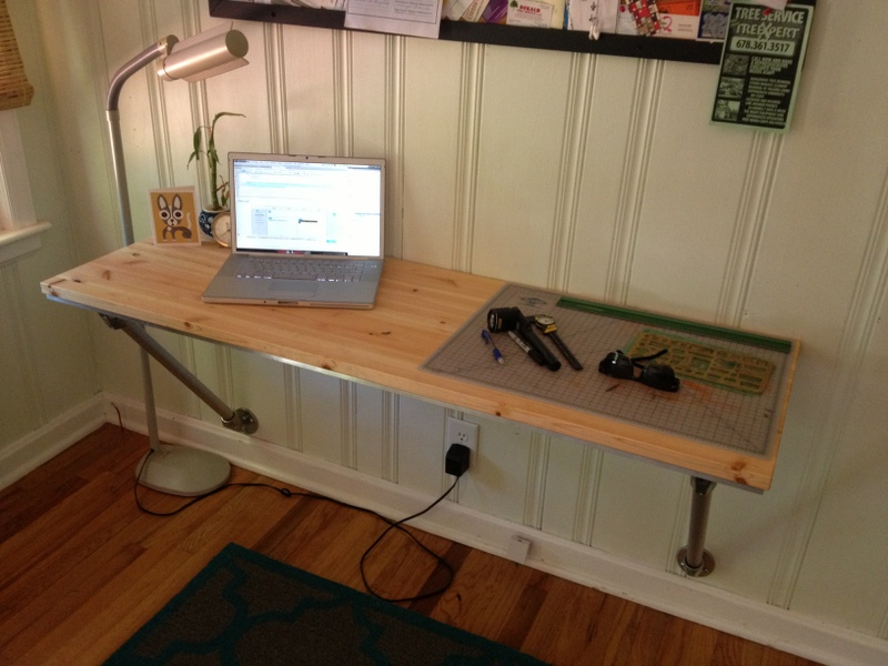 Wall mounted desk with angled supports for Best ways to save money when building a house