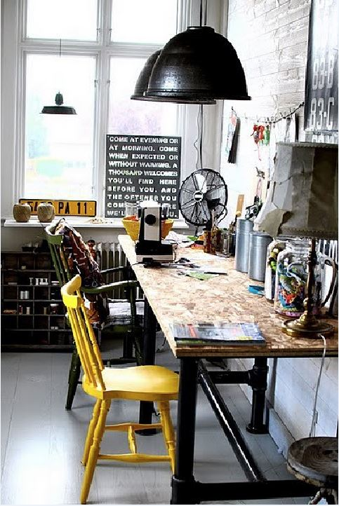 Industrial chipboard and pipe sewing desk