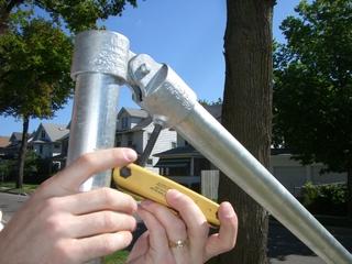 Tightening the set screw on the handrail