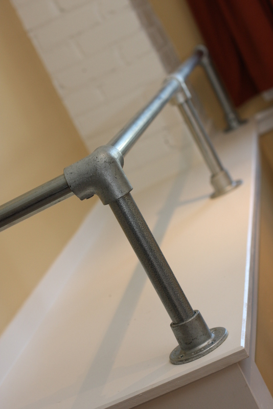 Interior industrial pipe handrail