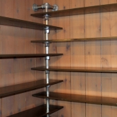 Wall Mounted Corner Bookshelf that Revitalizes Lost Space